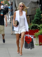 Nicky Hilton picked up her dry cleaning in style wearing a sleek white vest over a silk top.