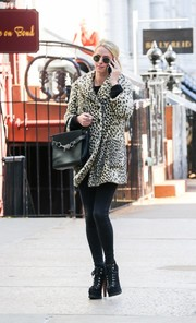 Nicky Hilton tied her look together with chunky black lace-up boots by Alaia.