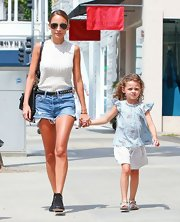 Nicole Richie kept her look casual and comfy by sporting a sleeveless white sweater with a pair of cropped shorts.