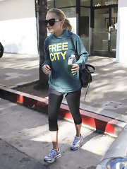 Nicole wears a Free City sweatshirt for her workout at the gym.