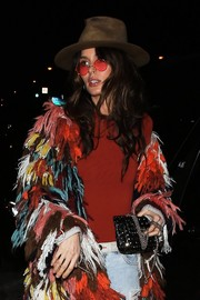 Nicole Trunfio was spotted outside Catch sporting a studded black bag and multicolored coat combo.