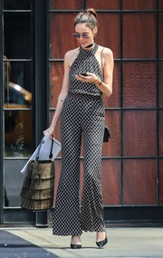 Nicole Trunfio stepped out of the Bowery Hotel looking chic in a black-and-white diamond-patterned halter jumpsuit.