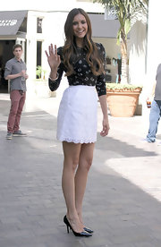 Nina went for a black-and-white color scheme in this print blouse and white skirt.