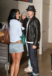 The actor looked stylish in a classic fedora with a leather jacket and cuffed jeans.