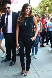 Nina Dobrev chose a pair of chic black silk pants, also by Elie Saab, to complete her outfit.