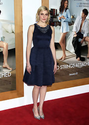 Greta let her midnight blue frock speak for itself, accessorizing with understated 18-karat white gold bangles.