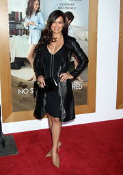 Tia Carrere added polish to her monochromatic look with a black leather clutch.