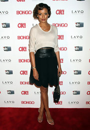 OK Magazine celebrated Hollywood's Sexiest Singles with a star-studded party. Selita Ebanks did not disappoint with a pair of sultry champagne heels and a quilted Chanel bag. The model looked both refined and sexy in a white blouse and full black skirt.