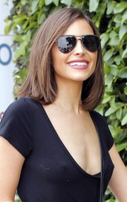Olivia Culpo finished off her look with a pair of black aviators.