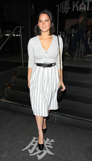 Olivia Munn looked sweet in a button-down cardigan and belted striped skirt.