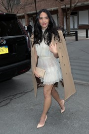 Olivia Munn added some warmth with a beige wool coat.