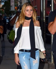 Olivia Palermo took a stroll in New York City wearing a black Paige scarf teamed with a cute off-the-shoulder top.