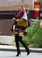Olivia Palermo was spotted out in New York City rocking a multicolored Burberry poncho with a pair of sexy thigh-high boots.