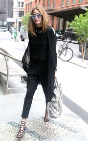 Olivia Palermo continued the dark motif with a pair of cropped pants.