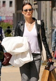 Olivia Wilde went shopping in New York City wearing a white V-neck tee with a black leather jacket.