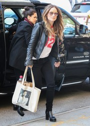 Olivia Wilde went shopping in New York City carrying a Joan Didion tote from the Literary Hub.