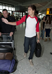 Liam Payne raced through Heathrow Airport in a classic white and red baseball tee.