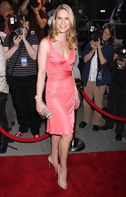 Stephanie March showed off her sultry side in a hip hugging coral dress. She paired her look with a cool gemstone inlaid clutch.
