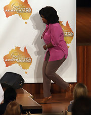 Oprah Winfrey teamed tan slacks with a pink blouse for the 'Ultimate Australian Adventure' press conference.