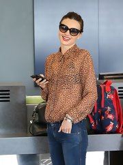 Miranda loves to wear sheer button-down blouses like this leopard number.
