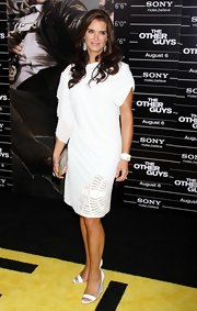 Brooked looked pristine in a draped white cocktail dress with summery wedge sandals.
