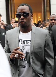 Sean Combs went shopping in Paris wearing an elegant gray suit and a cool pair of wayfarers.