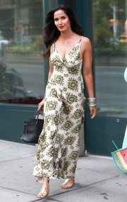 Padma Lakshmi kept it comfy yet elegant in silver thong sandals.