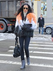 Padma Lakshmi sealed off her cold-weather look with gray suede ankle boots.