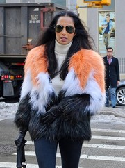 Padma Lakshmi teamed black leather gloves with a fuzzy coat for her cold-weather strolling attire.