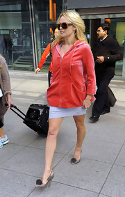 Pamela Anderson arrived in London wearing a pair of silvery gray heeled jellies.