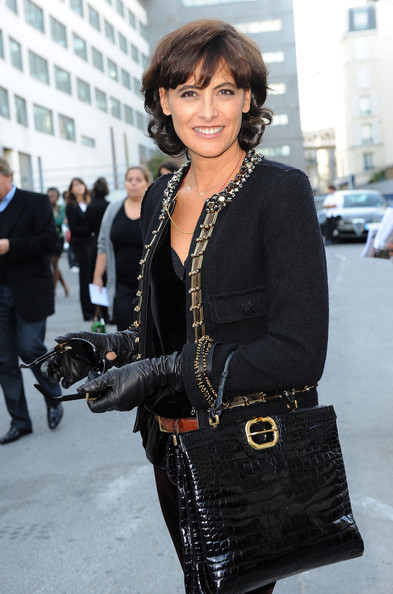 Ines de la Fressange carried another Roger Viver creation, this time a patent croc-skin briefcase at the Spring 2010 Lanvin show.