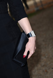 Dita paired her demure dress with a satin clutch, which worked well with her all black look.