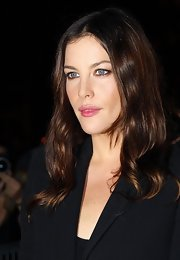 Liv Tyler showed off her radiant locks while hitting Paris Fashion Week.