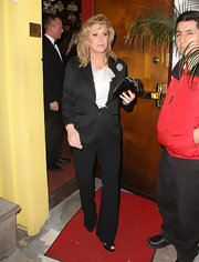 Kathy Hilton kept it modest at her birthday party with a black pantsuit and ruffled white blouse.