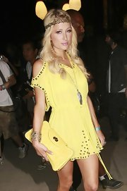 Paris lit up Coachella in a bright yellow ensemble completed by an oversized matching leather handbag.