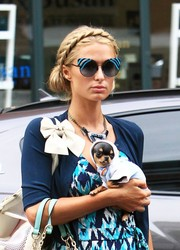 Paris Hilton coordinated her outfit with a pair of striped cateye sunglasses by Fendi.