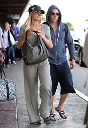 Paris Hilton arrived in Maui carrying a taupe leather shoulder bag embellished with gold stars.