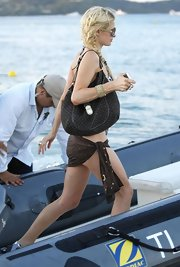 Paris Hilton paired her bikini with a canvas shoulder bag.