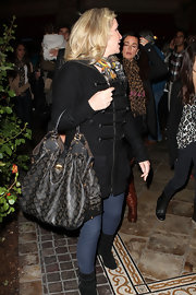 Kathy Hilton went shopping carrying a chic Louis Vuitton hobo bag.