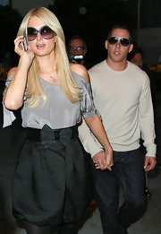 Paris Hilton hit the shops wearing a pair of gray-blue oversize sunglasses.