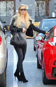 Paris Hilton toughened her uncharacteristically dark street style with a studded tote.