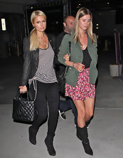 Nicky Hilton made strides after the Britney Spears concert in black suede mid-calf boots.