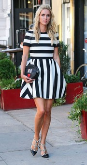 Nicky Hilton was sweet and chic on the streets of NYC in a fit-and-flare mini dress featuring a stylish blend of vertical and horizontal stripes.