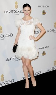 Georgina Chapman balanced her frothy white frock with classic black pumps.
