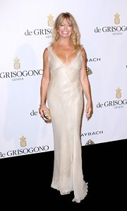 Goldie Hawn carried a glam golden clutch to the Grisogono party during Cannes Film Festival.