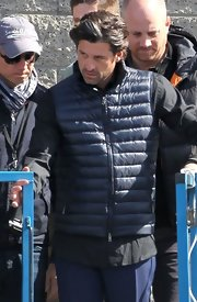 Patrick Dempsey looked sporty and cool in a blue puffa vest on the set of a L'Oreal commercial.