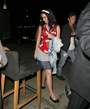 Katy Perry carried her patriotic stars and stripes denim jacket for the 4th of July.