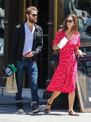 Phoebe Tonkin was sweet and girly in a fuchsia print dress while running errands in New York City.