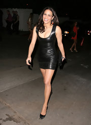 Paula Patton paired her daring leather mini dress with classic black platform pumps.