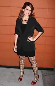 Nia Vardalos matched her red lips to ruby patent peep-toes. What do you think of her choice of tights?